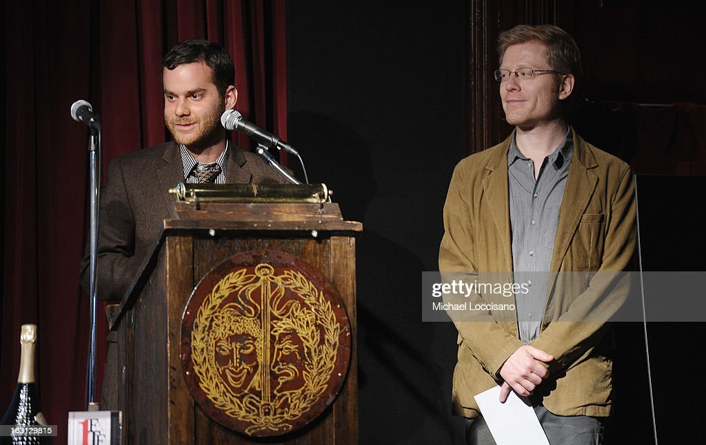 Director Max Weissberg accepts an award while actor Anthony Rapp looks on during the 2013 First Time Fest closing night awards at The Players Club on March 4, 2013 in New York City.