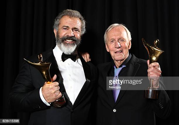SYDNEY NSW Director Mel Gibson Best Film Award winner and Paul Hogan Longford Lyell Award winner pose backstage at the 2016 AACTA Awards at The Star...