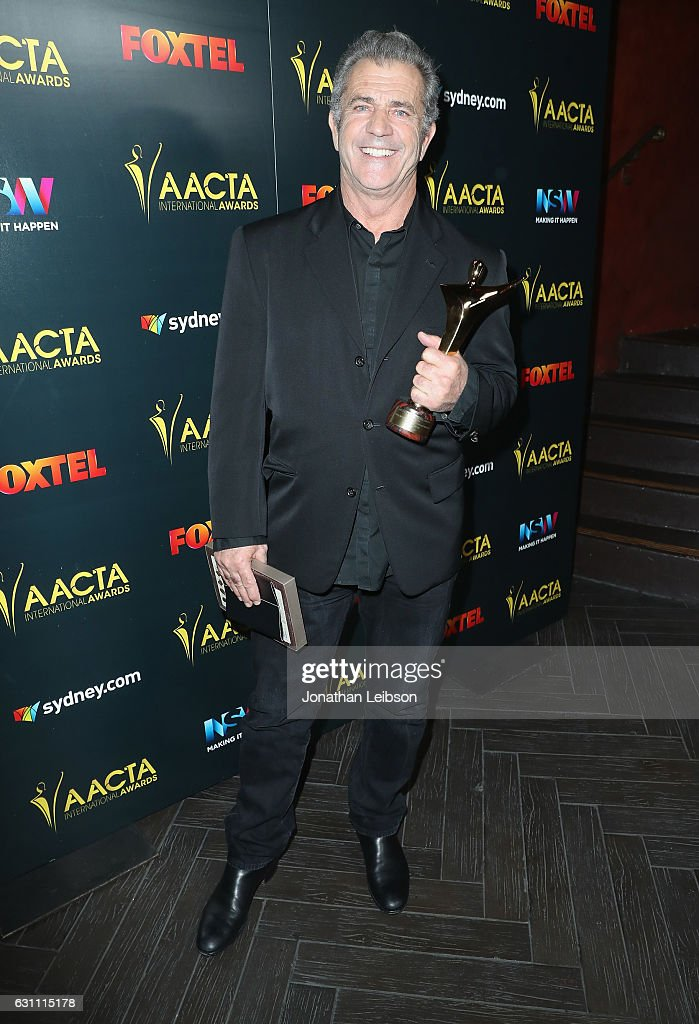 Director Mel Gibson poses with award for Best Direction for Hacksaw Ridge at The 6th AACTA International Awards on January 6, 2017 in Los Angeles, California.