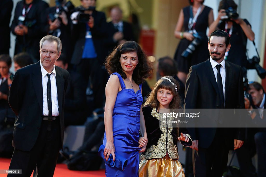 Director <a gi-track='captionPersonalityLinkClicked' href=/galleries/search?phrase=Merzak+Allouache&family=editorial&specificpeople=7295827 ng-click='$event.stopPropagation()'>Merzak Allouache</a>, actors Meriem Medjkane, Myriam Ait El Hadj and Nadjib Oulebsir attend 'Les Terrasses' premiere during the 70th Venice International Film Festival at Palazzo del cinema on September 6, 2013 in Venice, Italy.