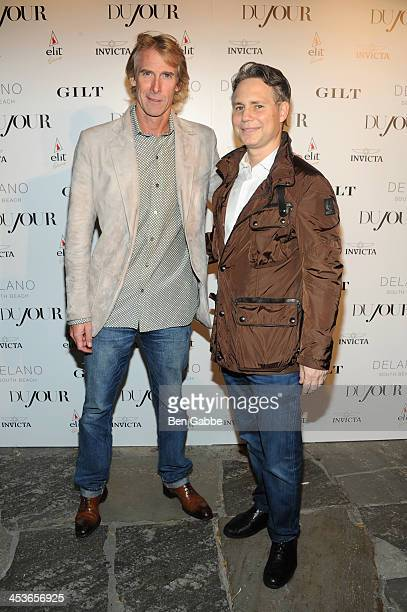 Director Michael Bay and Jason Binn attend DuJour Magazine's event to honor artist Marc Quinn at Delano South Beach Club on December 4 2013 in Miami...