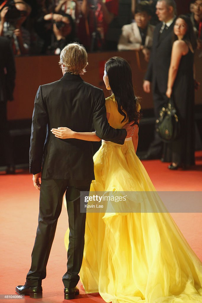 Director Michael Bay and <a gi-track='captionPersonalityLinkClicked' href=/galleries/search?phrase=Li+Bingbing&family=editorial&specificpeople=697017 ng-click='$event.stopPropagation()'>Li Bingbing</a> poses for a picture at the Shanghai premiere of 'Transformers' on June 22, 2014 in Shanghai, China.