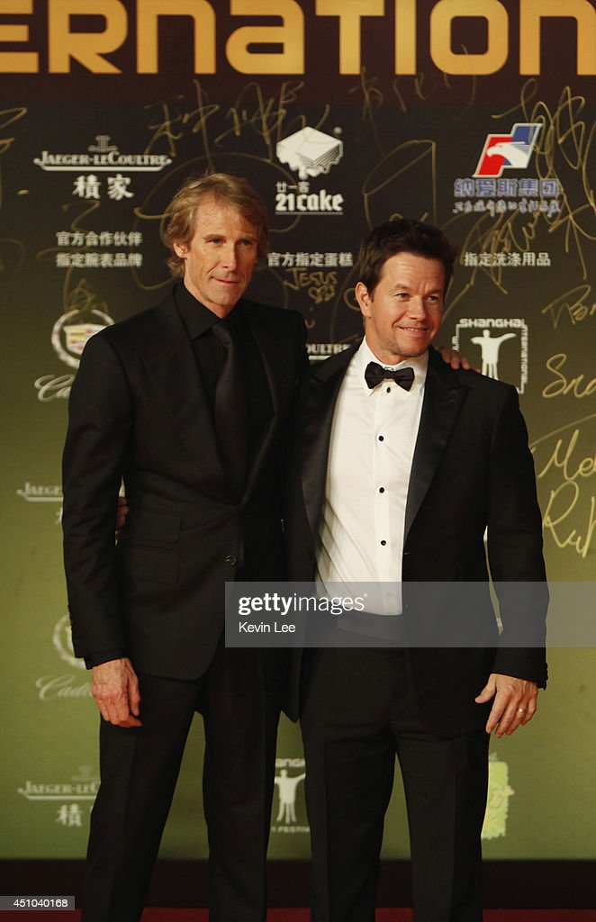 Director Michael Bay and <a gi-track='captionPersonalityLinkClicked' href=/galleries/search?phrase=Mark+Wahlberg&family=editorial&specificpeople=202265 ng-click='$event.stopPropagation()'>Mark Wahlberg</a> poses for a picture at the Shanghai premiere of 'Transformers' on June 22, 2014 in Shanghai, China.