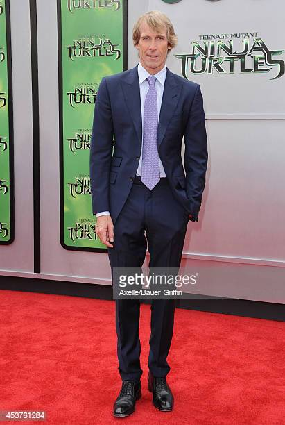 Director Michael Bay arrives at the Los Angeles Premiere of 'Teenage Mutant Ninja Turtles' at Regency Village Theatre on August 3 2014 in Westwood...