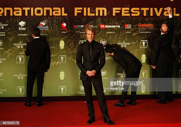 Director Michael Bay poses for a picture after he signed his name at the Shanghai premiere of 'Transformers' on June 22 2014 in Shanghai China