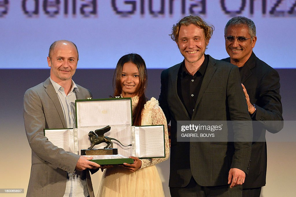 Director Michael Cody (L), actress Sang Malen and director Amiel Courtin-Wilson (2ndR) pose on stage with the Special Orizzonti Jury Price they received for their movie 'Ruin' during the award ceremony of the 70th Venice Film Festival on September 7, 2013 at Venice Lido.