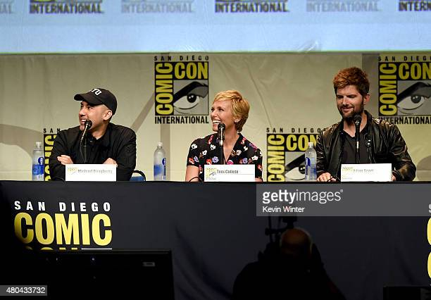 Director Michael Dougherty actress Toni Colette and actor Adam Scott from 'Krampus' speak onstage at the Legendary Pictures panel during ComicCon...