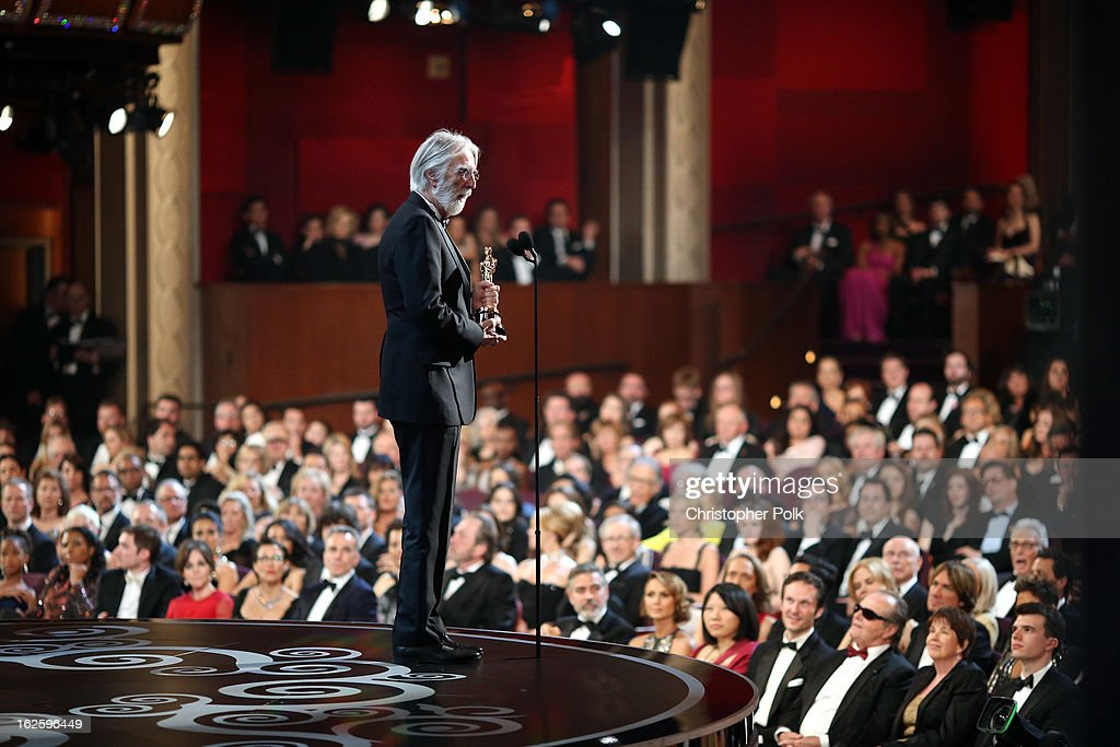 Director <a gi-track='captionPersonalityLinkClicked' href=/galleries/search?phrase=Michael+Haneke&family=editorial&specificpeople=233739 ng-click='$event.stopPropagation()'>Michael Haneke</a> accepts the Best Foreign Language Film award for 'Amour,' seen from backstage during the Oscars held at the Dolby Theatre on February 24, 2013 in Hollywood, California.