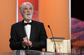 Director Michael Haneke receives the Palme D'Or for Amour onstage at the Closing Ceremony during the 65th Annual Cannes Film Festival