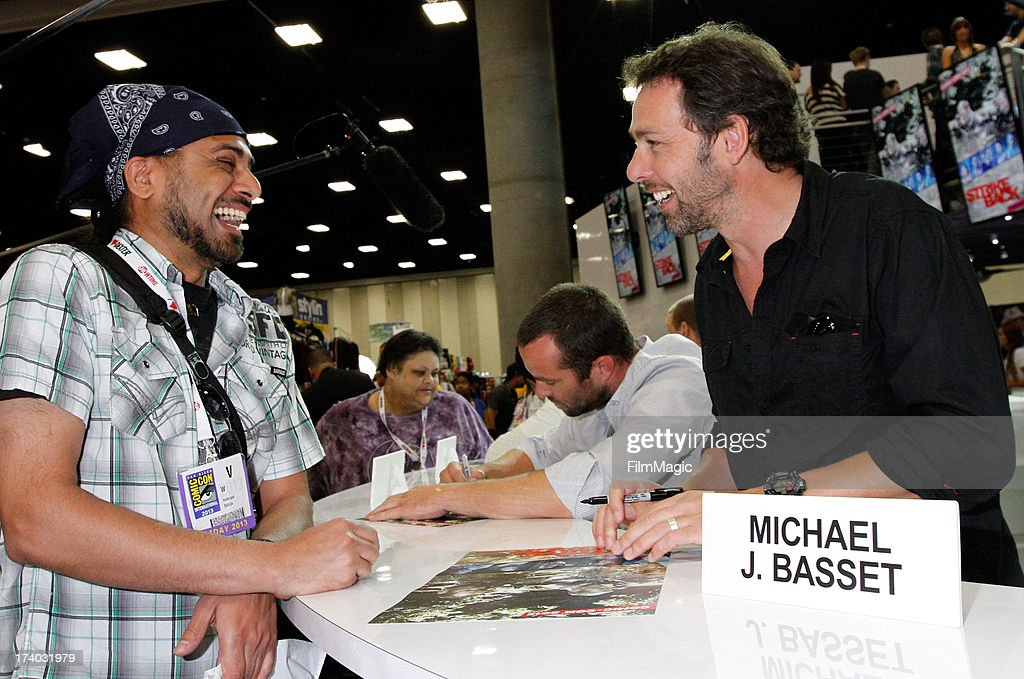 Director Michael J. Bassett (R) attends Cinemax's 'Strike Back' cast autograph signing at San Diego Convention Center on July 19, 2013 in San Diego, California.