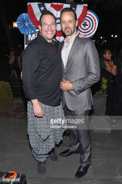 Director Michael Mayer and actor Noah Racey attend the after party as awardwinning filmmaker Michael Moore celebrates his Broadway Opening Night in...