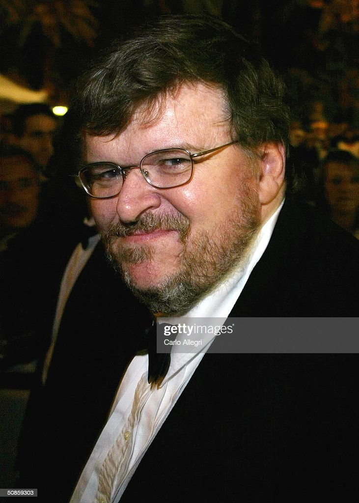 Director Michael Moore is seen leaving the 'Exiles' premiere during the 'Diarios de Motocicleta (Motorcycle Diaries)' premiere at the Palais des Festivals during the 57th International Cannes Film Festival May 20, 2004 in Cannes, France.