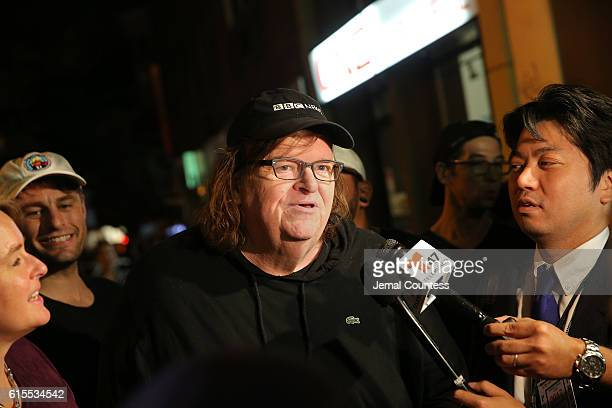 Director Michael Moore speaks to the media at the premiere of his documentary 'Michael Moore In TrumpLand' at the IFC Center on October 18 2016 in...