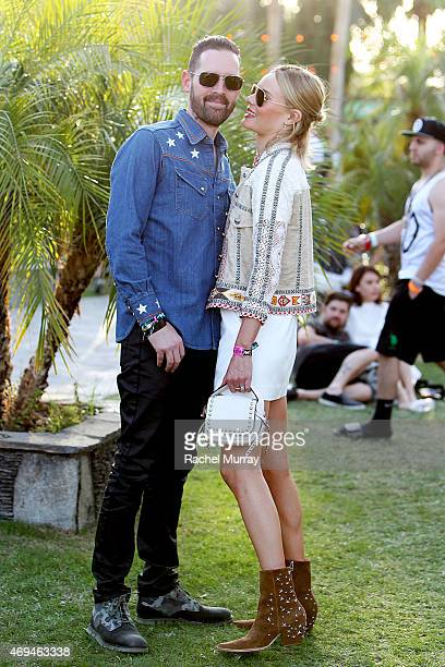 Director Michael Polish and Kate Bosworth wearing a Coach handbag and boots she designed for her Matisse shoe line attend the 2015 Coachella Valley...