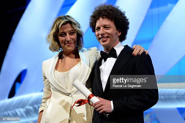 Director Michel Franco poses onstage after being awarded the Best Screenplay Prize for his film 'Chronic' by actress Valerie BruniTedeschi at the...