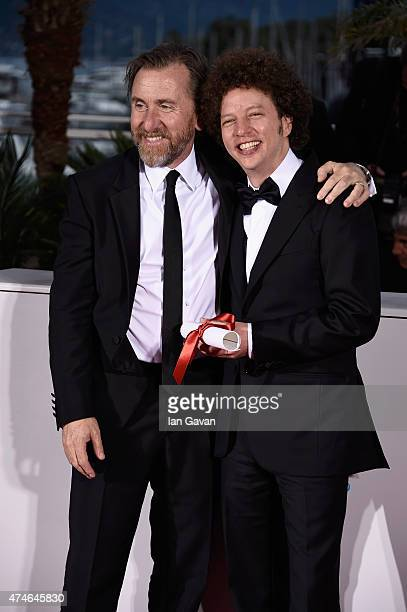 Director Michel Franco winner of the Best Screenplay Prize for his film 'Chronic' poses with actor Tim Roth at a photocall for the winners of the...