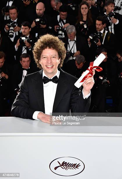 Director Michel Franco winner of the Best Screenplay Prize for his film 'Chronic' poses at a photocall for the winners of the Palm D'Or during the...