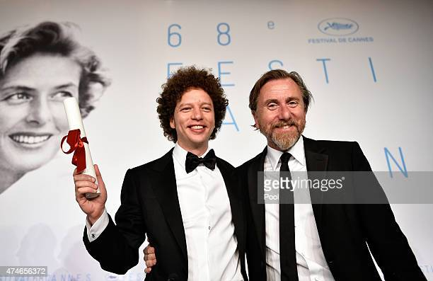 Director Michel Franco winner of the Best Screenplay Prize for his film 'Chronic' poses with actor Tim Roth during the Palm D'Or Winners press...