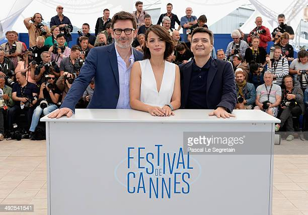 Director Michel Hazanavicius actress Berenice Bejo and producer Thomas Langmann attend 'The Search' photocall at the 67th Annual Cannes Film Festival...