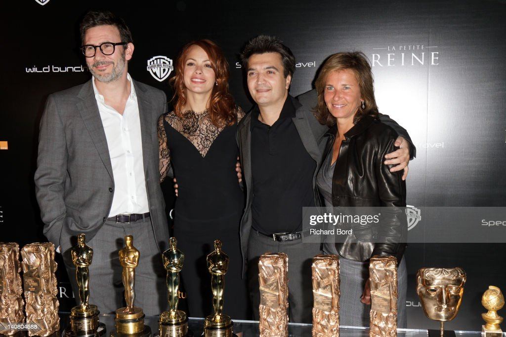 Director Michel Hazanavicius actress Berenice Bejo producer Thomas Langmann and guest pose with their awards during 'The Artist' PostAwards...