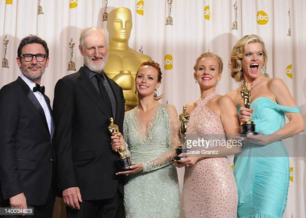 Director Michel Hazanavicius and actors James Cromwell Berenice Bejo Penelope Ann Miller and Missi Pyle pose in the press room at the 84th Annual...