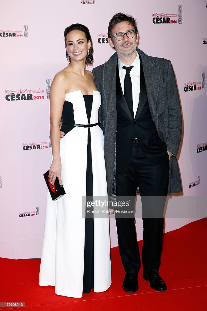Director Michel Hazanavicius (R) and actress Berenice Bejo arrive for the 39th Cesar Film Awards 2014 at Theatre du Chatelet on February 28, 2014 in Paris, France.