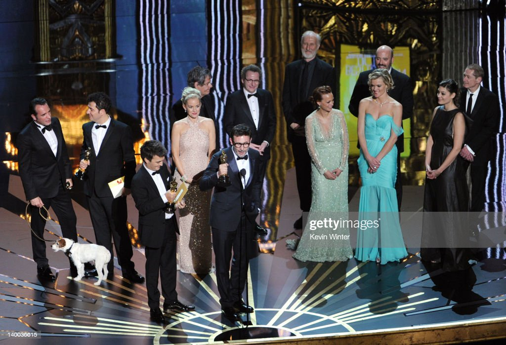 Director Michel Hazanavicius (C) and fellow members of the cast and crew celebrate 'The Artist' winning the Best Pictue Award onstage during the 84th Annual Academy Awards held at the Hollywood & Highland Center on February 26, 2012 in Hollywood, California.