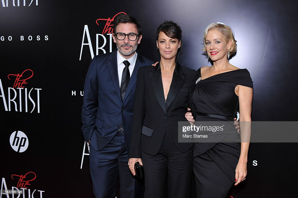 Director Michel Hazanavicius Berenice Bejo and Actress Penelope Ann Miller attend the premiere of 'The Artist' at the Paris Theater on November 17...