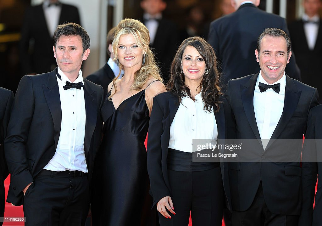 Director Michel Hazanavicius, guest, Berenice Bejo, and Jean Dujardin attend 'The Artist' premiere at the Palais des Festivals during the 64th Annual Cannes Film Festival on May 15, 2011 in Cannes, France.