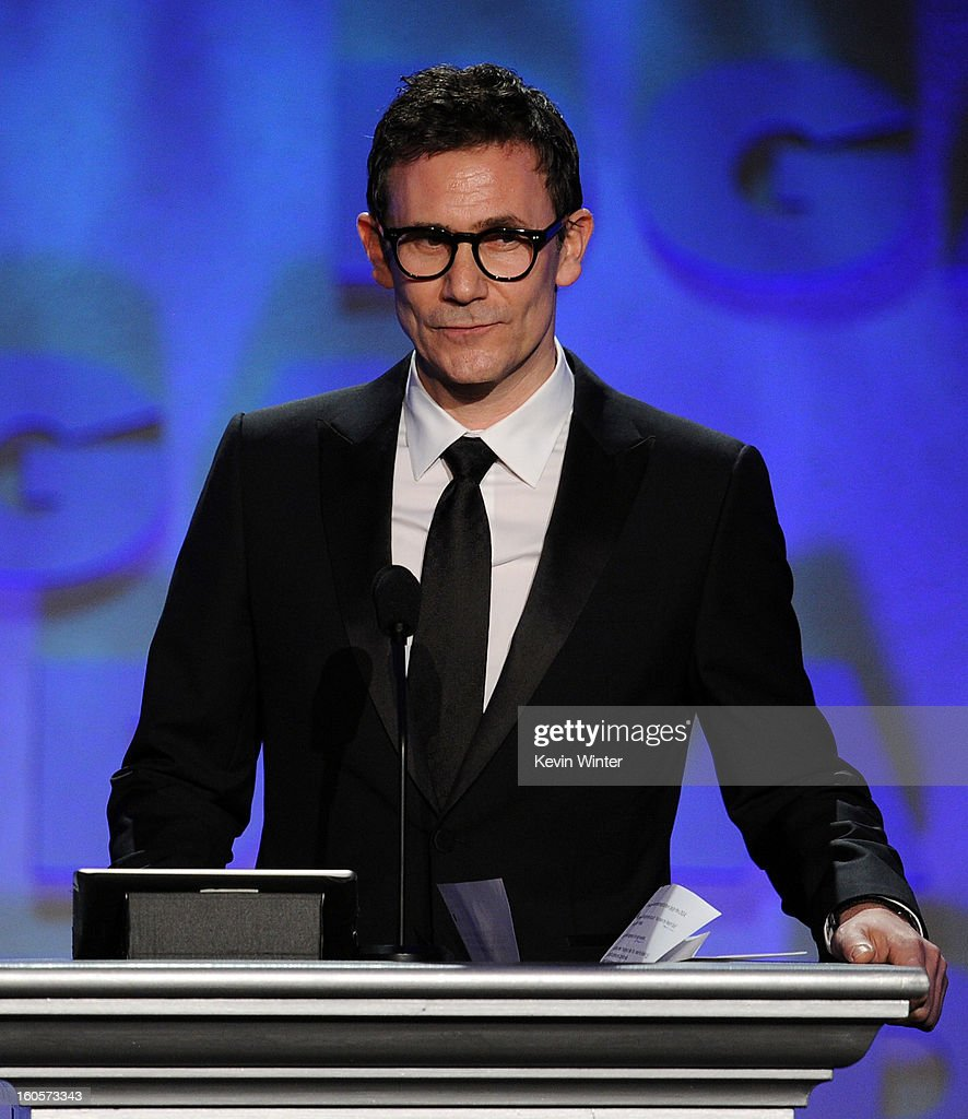 Director <a gi-track='captionPersonalityLinkClicked' href=/galleries/search?phrase=Michel+Hazanavicius&family=editorial&specificpeople=678372 ng-click='$event.stopPropagation()'>Michel Hazanavicius</a> speaks onstage during the 65th Annual Directors Guild Of America Awards at Ray Dolby Ballroom at Hollywood & Highland on February 2, 2013 in Los Angeles, California.