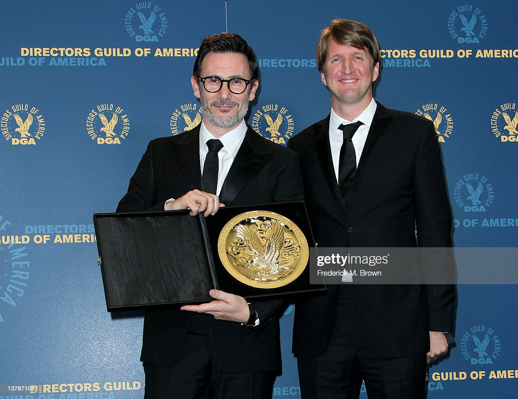 Director Michel Hazanavicius winner of the Outstanding Directorial Achievement in Feature Film for 2011 award for 'The Artist' and presenter Tom...