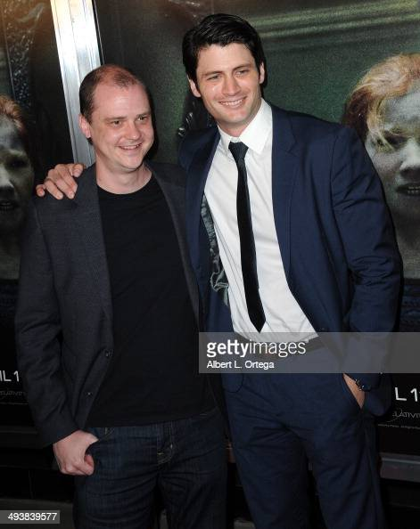 Director Mike Flanagan and actor James Lafferty attend the Screening Of Relativity Media's 'Oculus' held at TLC Chinese 6 Theatres on April 3 2014 in...