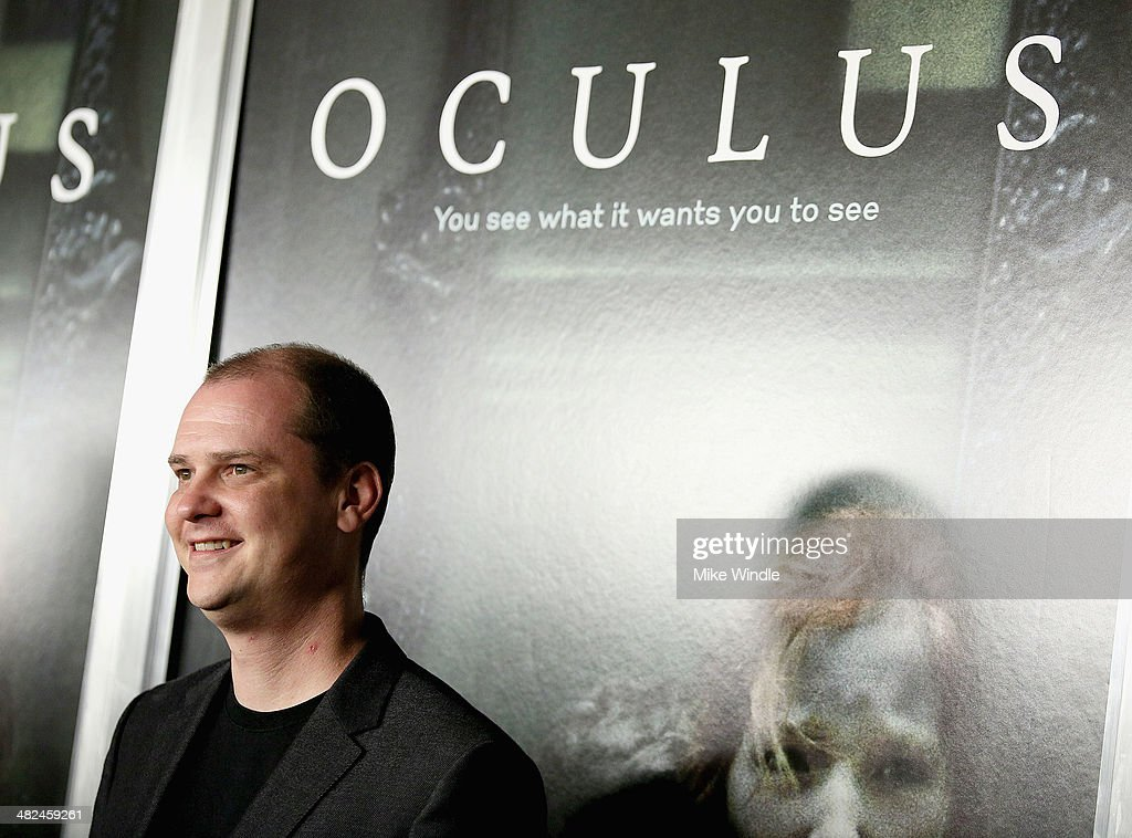 Director <a gi-track='captionPersonalityLinkClicked' href=/galleries/search?phrase=Mike+Flanagan&family=editorial&specificpeople=224999 ng-click='$event.stopPropagation()'>Mike Flanagan</a> arrives at the screening of Relativity Media's 'Oculus' at TCL Chinese 6 Theatres on April 3, 2014 in Hollywood, California.