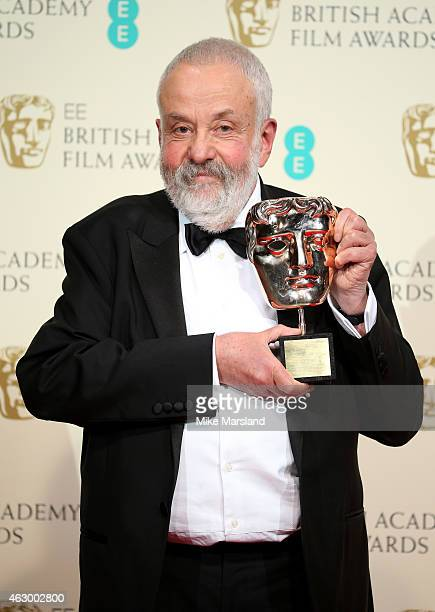 Director Mike Leigh winner of the Fellowship award poses in the winners room at the EE British Academy Film Awards at The Royal Opera House on...