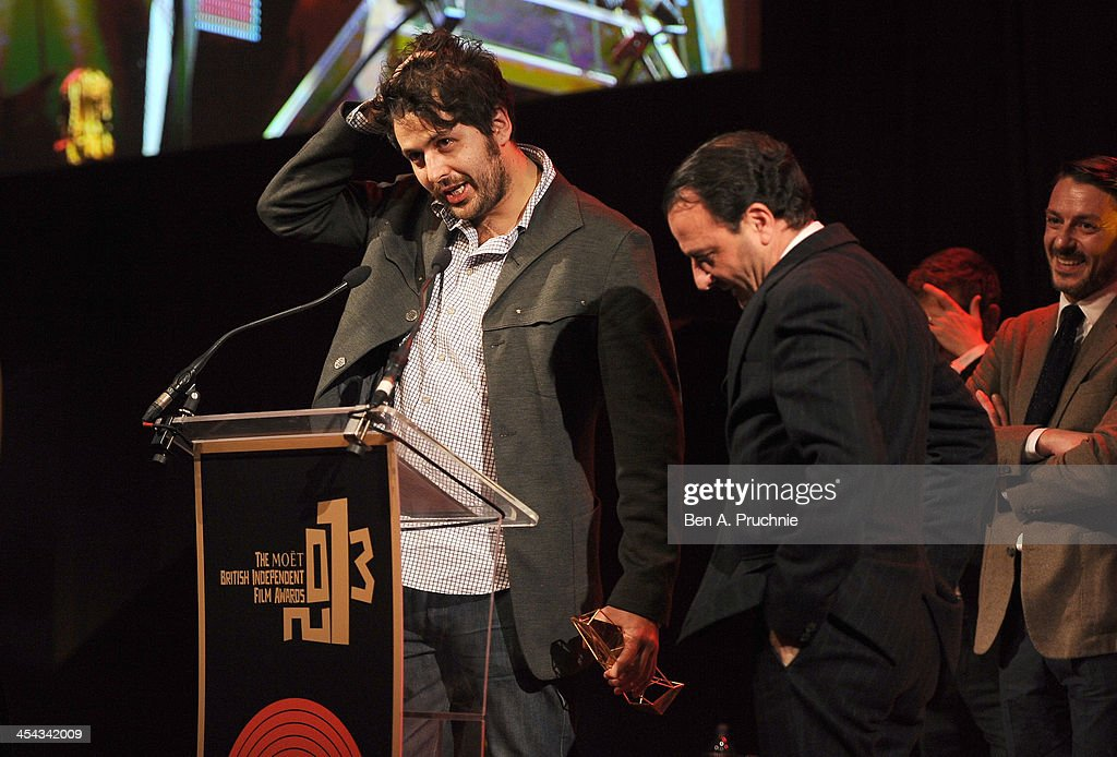 Director Mike Lerner (R) and Maxim Pozdorovkin receive the award for Best British Documentary for the film 'Pussy Riot: A Punk Prayer' during the ceremony for the Moet British Independent Film Awards at Old Billingsgate Market on December 8, 2013 in London, England.