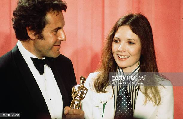 Director Milos Forman pose backstage after winning 'Best Director' for 'One Flew Over the Cuckoo's Nest' with actress Diane Keaton during the 48th...