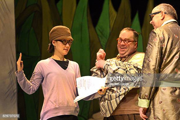 Director Mimi Katano works with actors Larry Coen and Neil A Casey during rehearsal of A Year with Frog and Toad at the Wheelock Family Theater in...