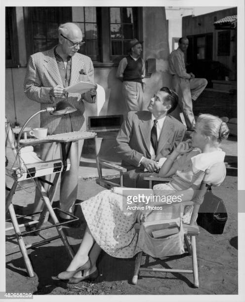 Director Mitchell Leisen and actors Glenn Ford and Nina Foch on the set of the movie 'Young Man with Ideas' 1952