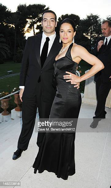 Director Mohammed Al Turki and Michelle Rodriguez attend the 2012 amfAR's Cinema Against AIDS during the 65th Annual Cannes Film Festival at Hotel Du...