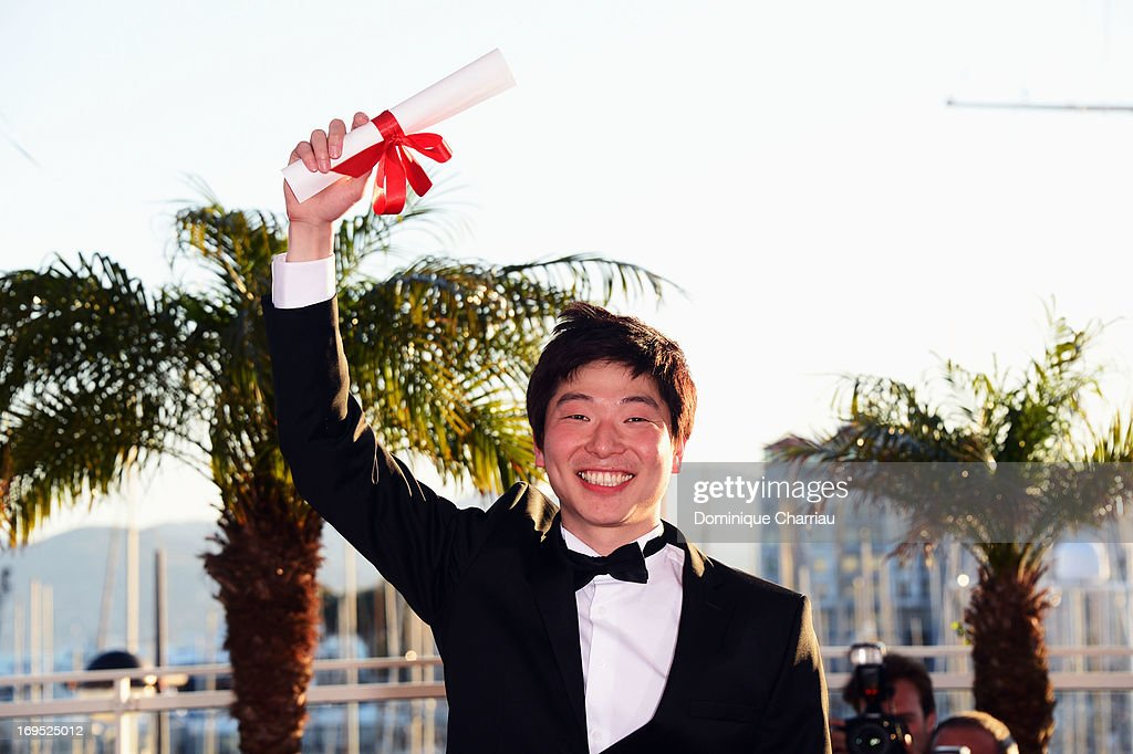 Director Moon Byung-gon poses after receiving the 'Palme d'Or' for the film 'Safe' at the photocall for award winners during the 66th Annual Cannes Film Festival at Palais des Festivals on May 26, 2013 in Cannes, France.
