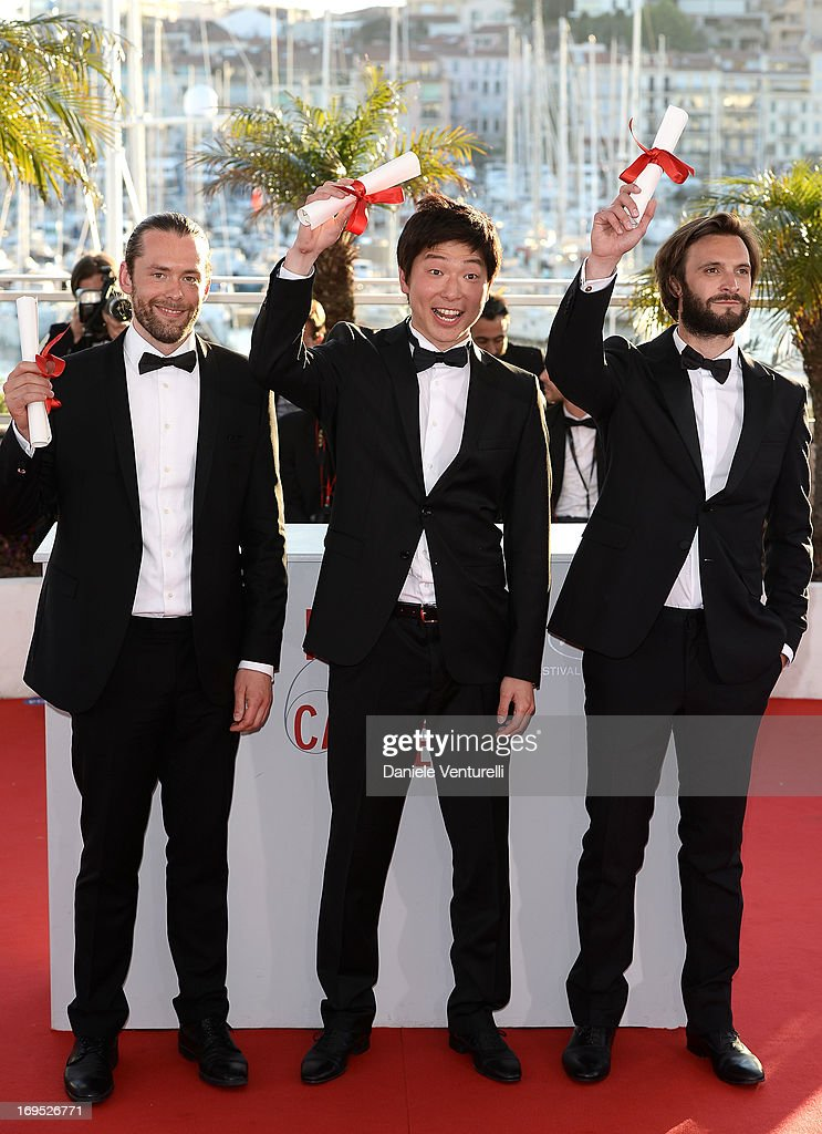 Director Moon Byung-gon (C) poses after receiving the 'Palme d'Or' for the film 'Safe' at the photocall for award winners during the 66th Annual Cannes Film Festival at Palais des Festivals on May 26, 2013 in Cannes, France.