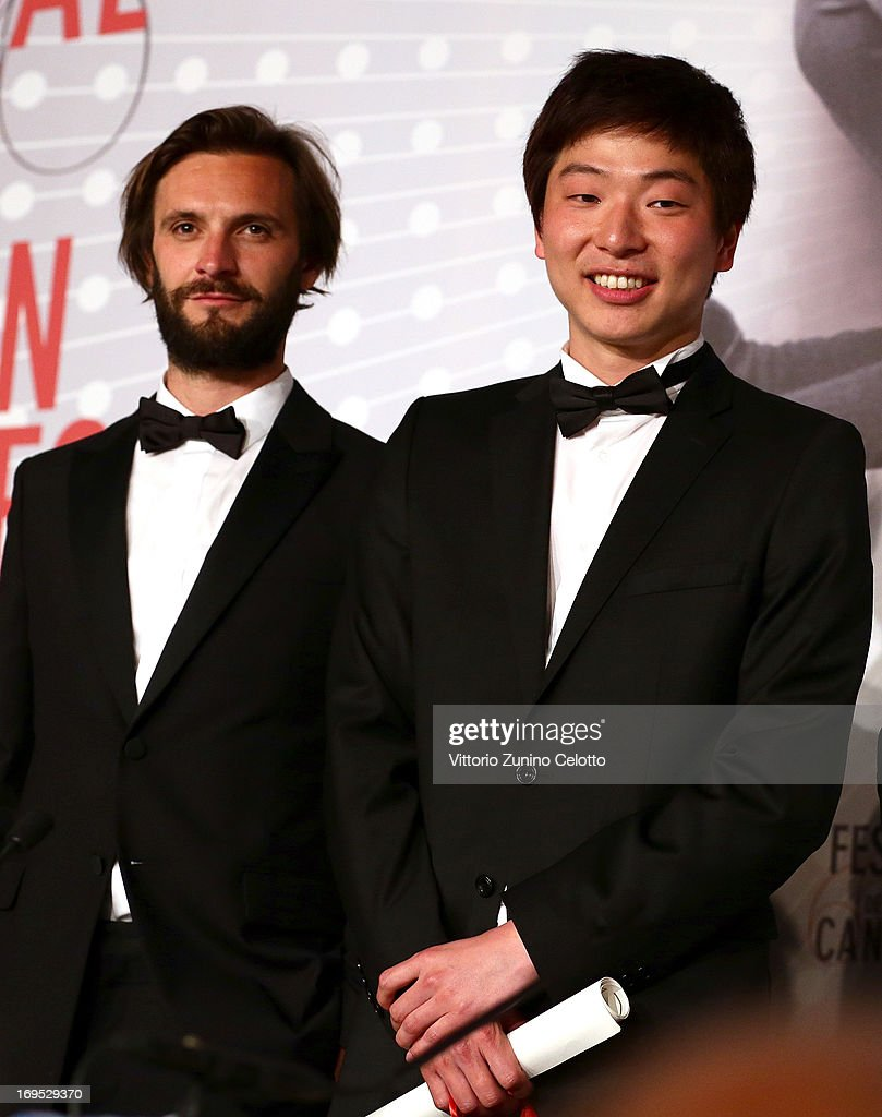 Director Moon Byung-gon (R), winner of the 'Palme d'Or' for the film 'Safe,' speaks the Palme D'Or Winners Press Conference during the 66th Annual Cannes Film Festival at the Palais des Festivals on May 26, 2013 in Cannes, France.