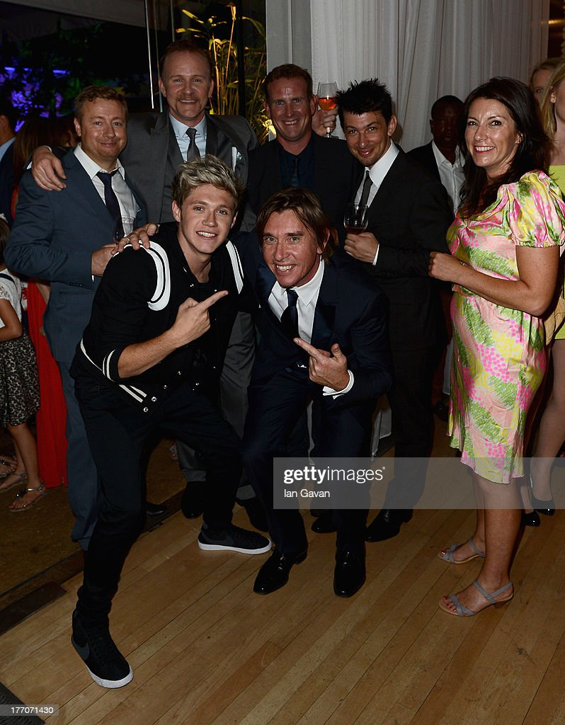 Director <a gi-track='captionPersonalityLinkClicked' href=/galleries/search?phrase=Morgan+Spurlock&family=editorial&specificpeople=212719 ng-click='$event.stopPropagation()'>Morgan Spurlock</a> (back, second left), <a gi-track='captionPersonalityLinkClicked' href=/galleries/search?phrase=Niall+Horan&family=editorial&specificpeople=7229827 ng-click='$event.stopPropagation()'>Niall Horan</a> from One Direction (front, left) and guests attend the 'One Direction This Is Us' world premiere after party on August 20, 2013 in London, England.
