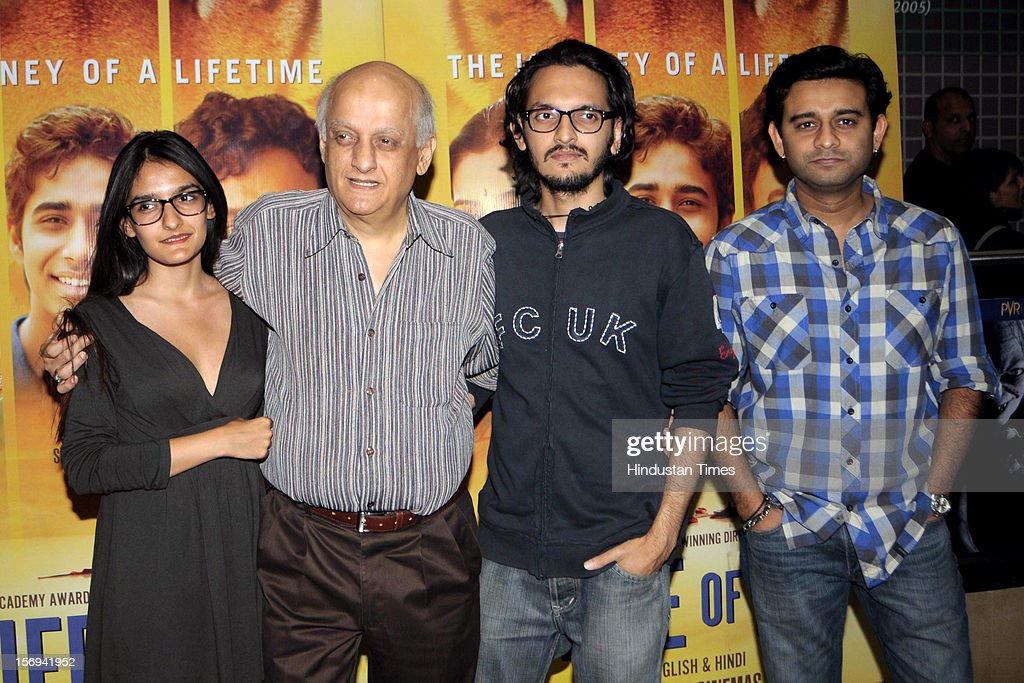 Director Mukesh Bhatt (C) with daugher Sakshi and Son Vishesh during the special screening of 'Life of PI' movie at PVR Juhu on November 21, 2012, in Mumbai, India. The film opens on November 13, 2012.