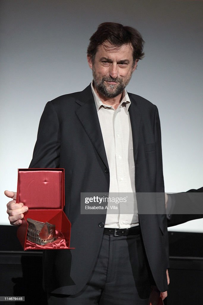 Director Nanni Moretti shows his award during the 2011 Lazio Screen Awards at Adriano Cinema on May 25, 2011 in Rome, Italy.