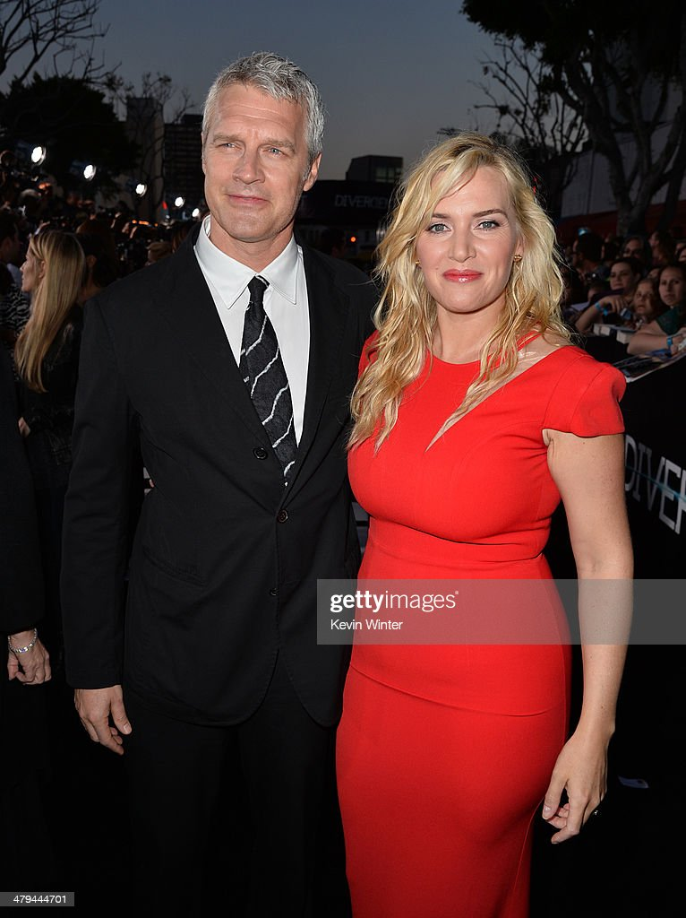 Director Neil Burger (L) and actress Kate Winslet arrive at the premiere of Summit Entertainment's 'Divergent' at the Regency Bruin Theatre on March 18, 2014 in Los Angeles, California.