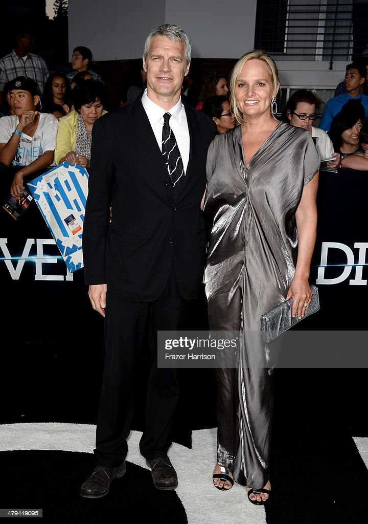 Director Neil Burger and Diana Kellogg arrive at the premiere of Summit Entertainment's 'Divergent' at the Regency Bruin Theatre on March 18 2014 in...