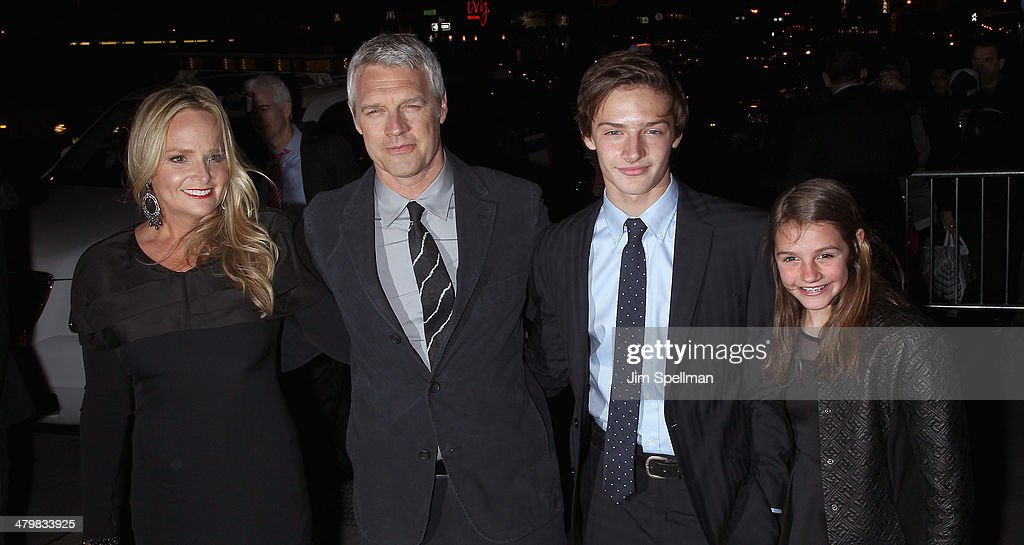Director Neil Burger (2nd from left) and family attend the Marie Claire & The Cinema Society screening of Summit Entertainment's 'Divergent' at Hearst Tower on March 20, 2014 in New York City.