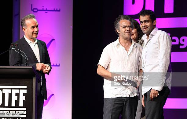 Director Nick Broomfield and Hakim Belabbes present Filmmaker Namir Abdel Messeeh of 'The Virgin The Copts and Me' Best Arab Documentary Film Award...