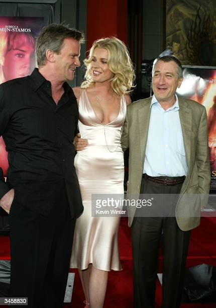 Director Nick Hamm with actors Rebecca RomijnStamos and Robert De Niro attend the world premiere of the Lion's Gate film 'Godsend' at the Mann's...